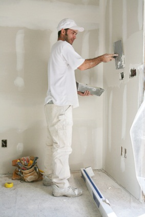 Drywall repair being performed by an experienced Scavello Handyman Services drywall technician.